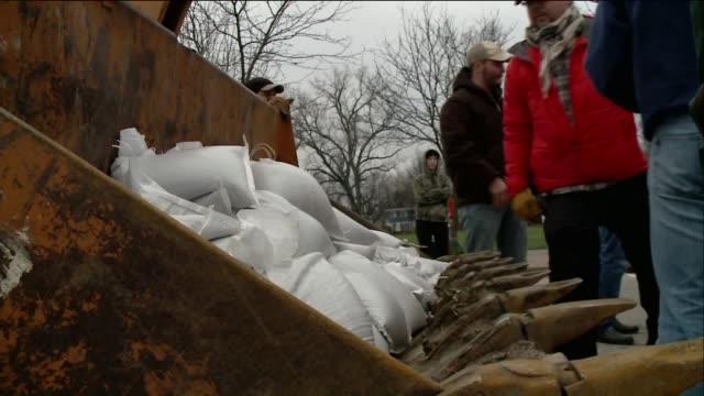 ktvi people pile sandbags into loader construction vehicle in preparation for flooding on december 29 2015 in st louis missouri - construction vehicle stock videos & royalty-free footage