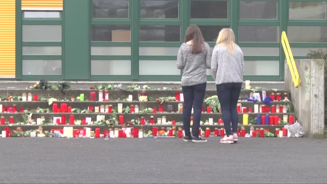 people place candles outside josephkonig high school in haltern which is about 40 miles from dusseldorf on march 25 2015 to commemorate 16 students... - temporäre gedenkstätte stock-videos und b-roll-filmmaterial