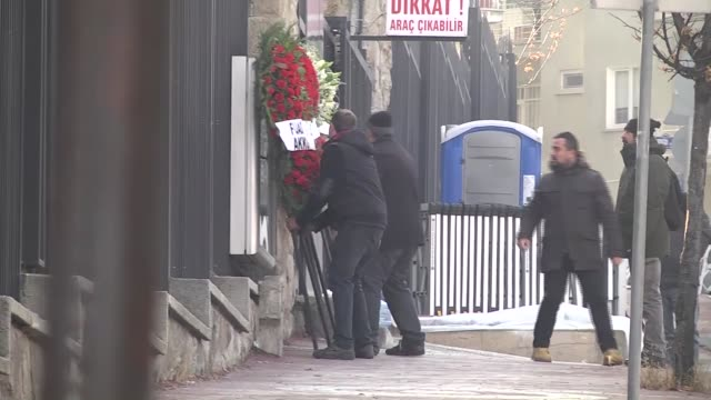 people place flowers and wreaths in front of the russian embassy in ankara to pay tribute to slain russian ambassador andrey karlov on december 20... - assassination of andrei karlov stock videos & royalty-free footage