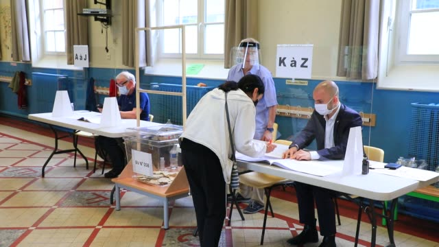 people place their vote in ballot box in a polling station in the 15th arrondissement of paris during the second round of mayoral elections on june... - politics illustration stock videos & royalty-free footage