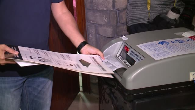 wgn people placing ballots into voting machine on election day in chicago on nov 8 2016 - wahlschein stock-videos und b-roll-filmmaterial