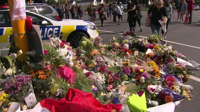 people placing flowers at floral memorial for victims of christchurch terror attacks near masjid al noor mosque, deans avenue, christchurch. - mosque stock videos & royalty-free footage