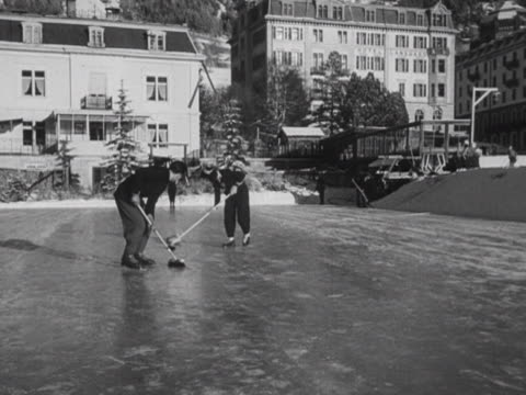 People play a game of curling on an open air ice rink in Zurich