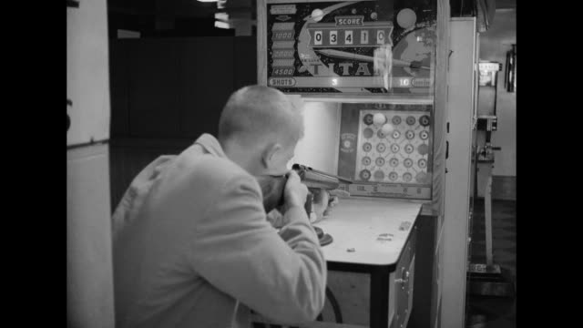 1962 People play arcade games
