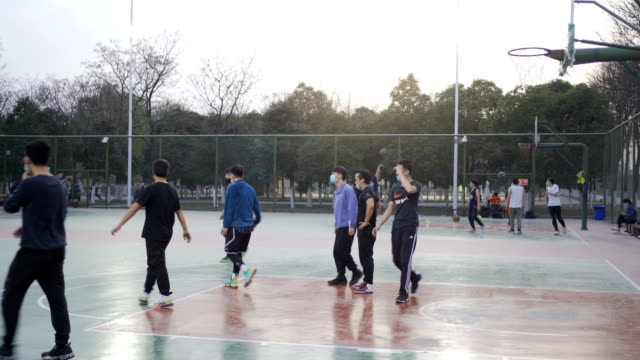 people play basketball - china film group stock videos & royalty-free footage