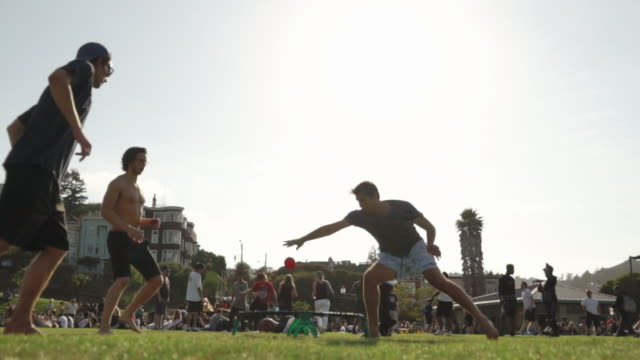 people play hacky sack (foot bag) on sunny day in dolores park, san francisco usa - bean bag stock videos and b-roll footage