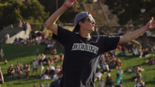 people play hacky sack (foot bag) on sunny day in dolores park, san francisco usa - bean bag stock videos & royalty-free footage