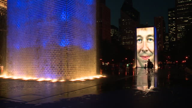 WGN People Play in Water Around Chicago's Crown Fountain at Night on Sept 20 2017