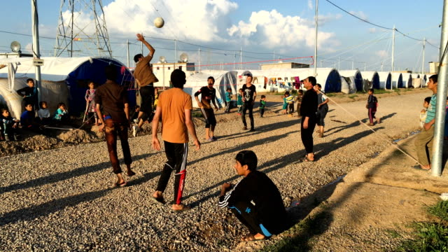 People play volleyball in Khazir refugee camp near Mosul Iraqi forces backed by US and British air support have entered their sixth month of fighting...