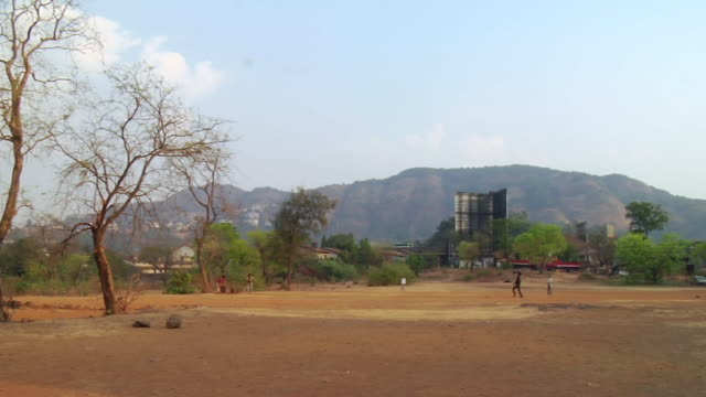 WS People playing cricket at tiger valley, mountains in background  / Khandala, Maharashtra, India