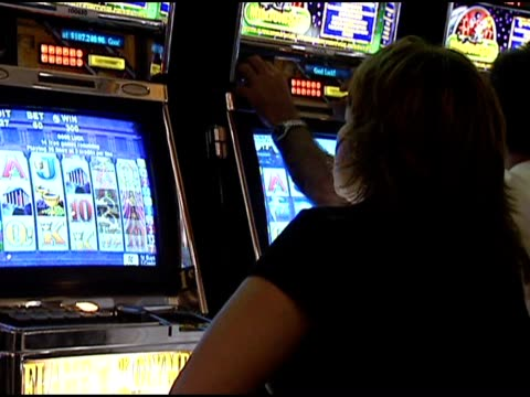 people playing electronic slot machines - fruit machine stock videos & royalty-free footage