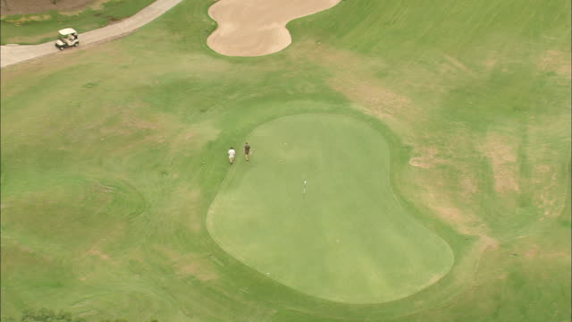 MS AERIAL ZO People playing golf at golf course / Texas, United States