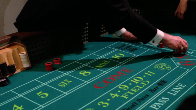 ms pan people playing on crap table in casino - dice stock videos & royalty-free footage