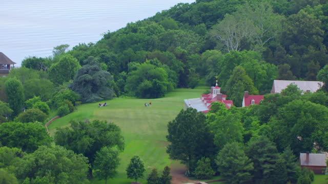 ws aerial pov zo people playing on lawn outside mount vernon near potomac river / fairfax county, virginia, united states - バージニア州マウントヴァーノン点の映像素材/bロール