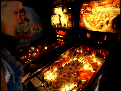 people playing on pinball machine in san francisco - pinball machine stock videos & royalty-free footage