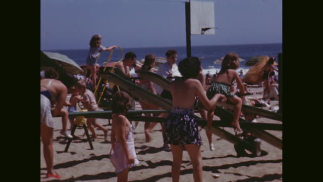 vídeos de stock, filmes e b-roll de ws people playing on seesaw and slide at beach / avila beach, california, united states - tempo real