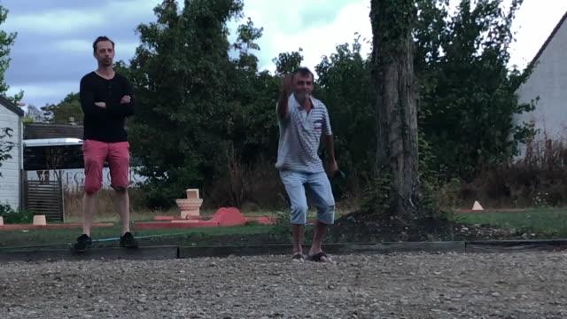 """vidéos et rushes de people playing petanque at campsite near paris france - """"bbc news"""""""