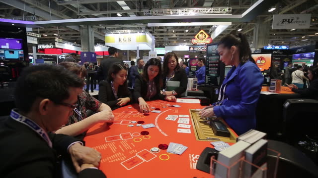 people playing poker at the global gaming expo asia in macau, china, on tuesday, may 21, 2019. - croupier stock videos & royalty-free footage