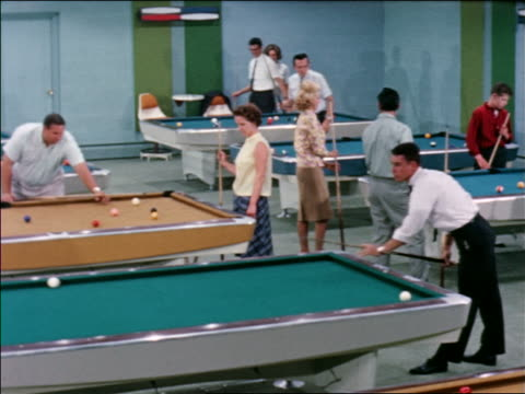 1963 people playing pool in busy pool hall / industrial - pool hall stock videos and b-roll footage