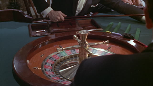 1966 ms people playing roulette in casino - roulette stock videos and b-roll footage