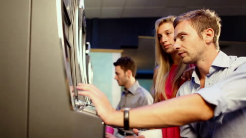 people playing slot machine at casino - gambling stock videos & royalty-free footage