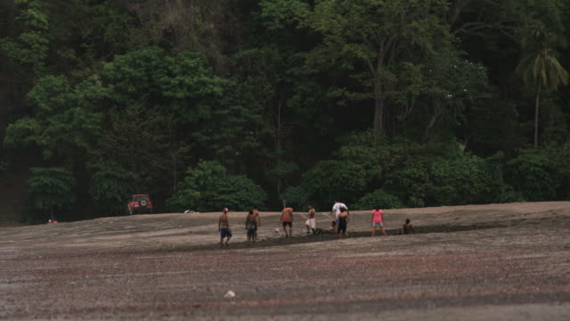 people playing soccer on the beach - costa rica stock videos and b-roll footage