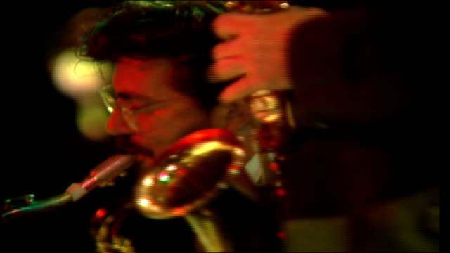 cu people playing various types of saxophones and trombones in nyc - alto saxophone stock videos and b-roll footage