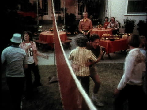 1974 montage people playing volleyball and drinking beer on hot day at lawn party / united states - 1974 stock videos and b-roll footage
