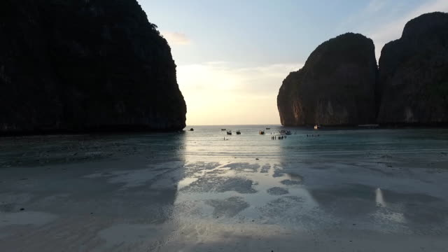 people playing water in the bay at sunset - phi phi le stock videos & royalty-free footage