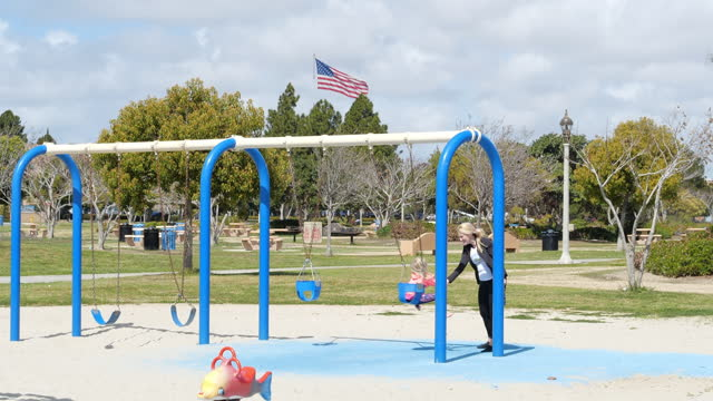 people playing with kid in the park in san diego amid the 2019 coronavirus pandemic. - baby girls stock videos & royalty-free footage