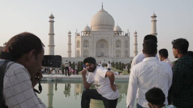 ws people posing in front of taj mahal / agra, india - agra stock videos and b-roll footage