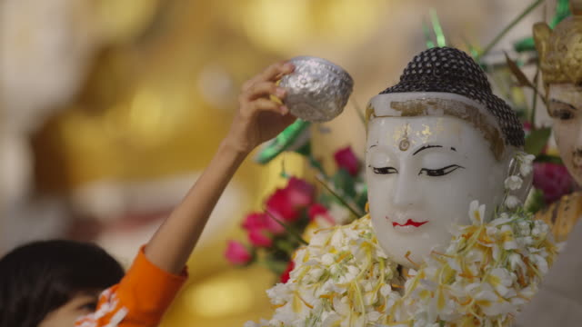 People pour water on head of deity statue in myanmar