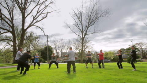 ws people practicing karate in local park / melbourne, victoria, australia - public park stock videos & royalty-free footage