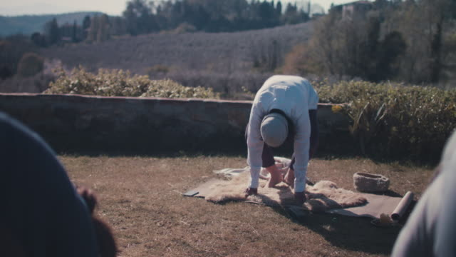people practicing yoga outside - tuscany stock videos and b-roll footage