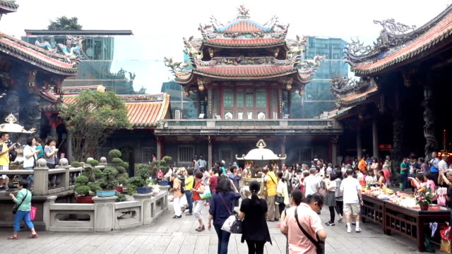 People pray in Longshan Buddhist temple in Taipei city, Taiwan