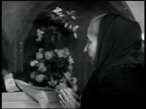 crypt people praying at crypt 'iv papa xi' woman praying intertitle 'today the church of rome endeavoring to pave the way for peace is marshaling all... - crypt stock videos and b-roll footage