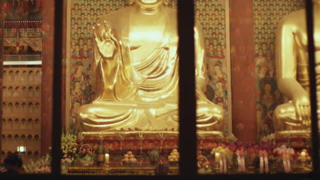 ms tu td people praying at jogyesa temple seen through window, buddha's birthday, seoul, south korea - buddha's birthday stock videos and b-roll footage