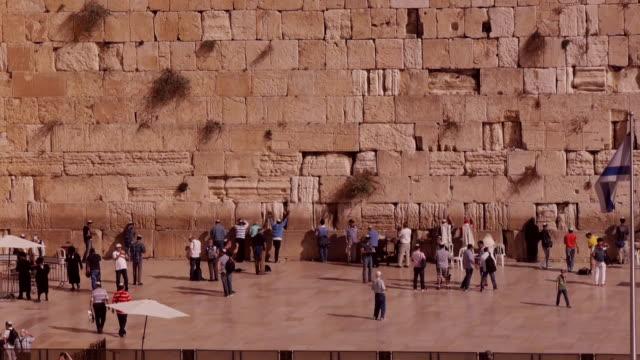 people praying at western wall in jerusalem - wailing wall stock videos & royalty-free footage