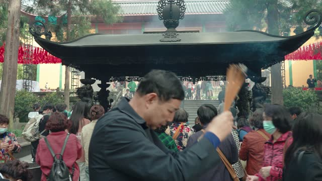 people praying for blessings at the ling yin buddhist temple,hangzhou,china. - shrine stock videos & royalty-free footage