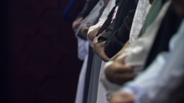 people praying in a mosque - koran stock videos and b-roll footage