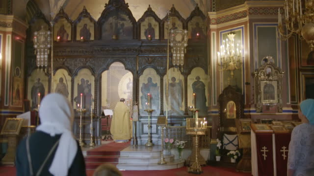 ws td people praying in saint alexander nevsky cathedral / paris, france - priest stock videos & royalty-free footage
