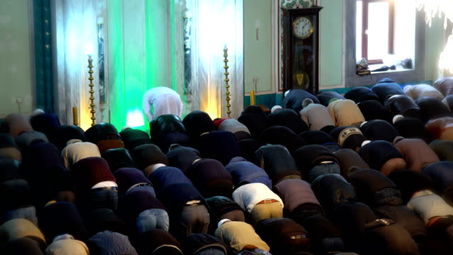 people praying together in mosque - middle east stock videos & royalty-free footage
