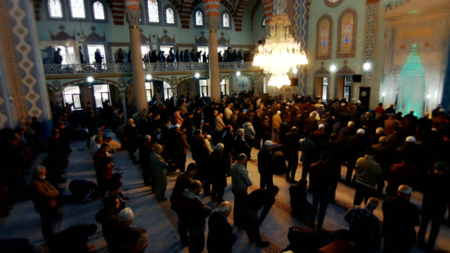 people praying together in mosque - pilgrim hat stock videos & royalty-free footage