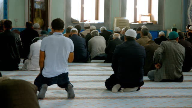 people praying together in mosque - islam stock videos & royalty-free footage