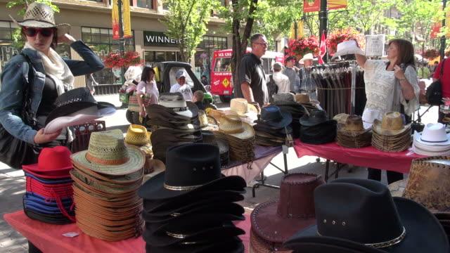 ms people preferring cowboy hats / calgary, alberta, canada - アルバータ州点の映像素材/bロール