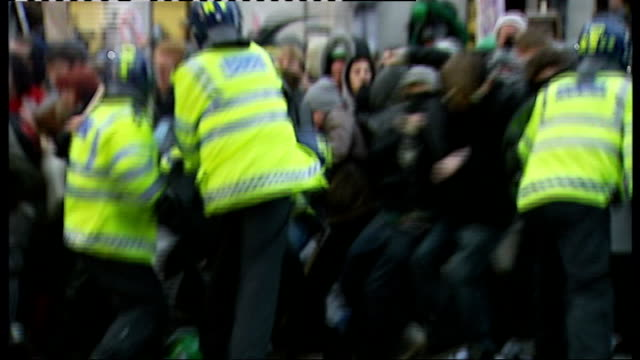 people prepare for tuc demonstration against government cuts; t01121011 riot police confronting student protestors during violent demonstrations - trades union congress stock videos & royalty-free footage