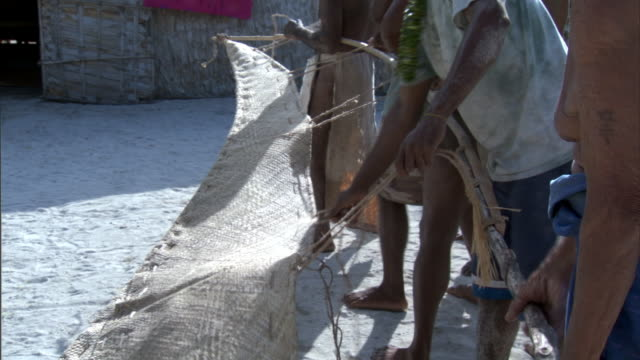 people prepare outrigger canoe sail, duff islands, solomon islands - polynesian culture stock videos and b-roll footage