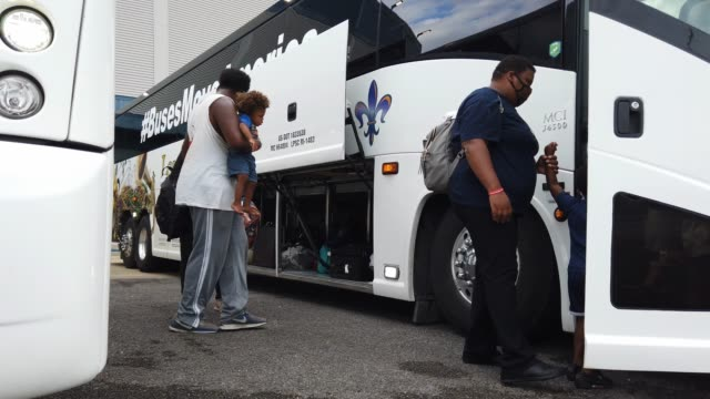 people prepare to board a bus as they are evacuated by local and state government officials before the possible arrival of hurricane laura on august... - preparation stock videos & royalty-free footage