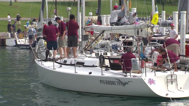 wgn people preparing boats near navy pier for the 107th annual race to mackinac on july 11 2015 more than 300 boats participated in the 333 mile race... - 麦わら帽子点の映像素材/bロール