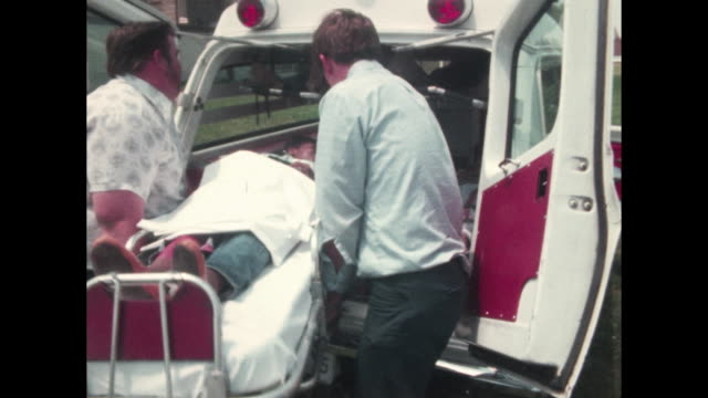 people pretending to be dead or injured and covered in fake blood lie on the ground and out the bus windows ambulance arrives and people are loaded... - fake hospital stock videos & royalty-free footage